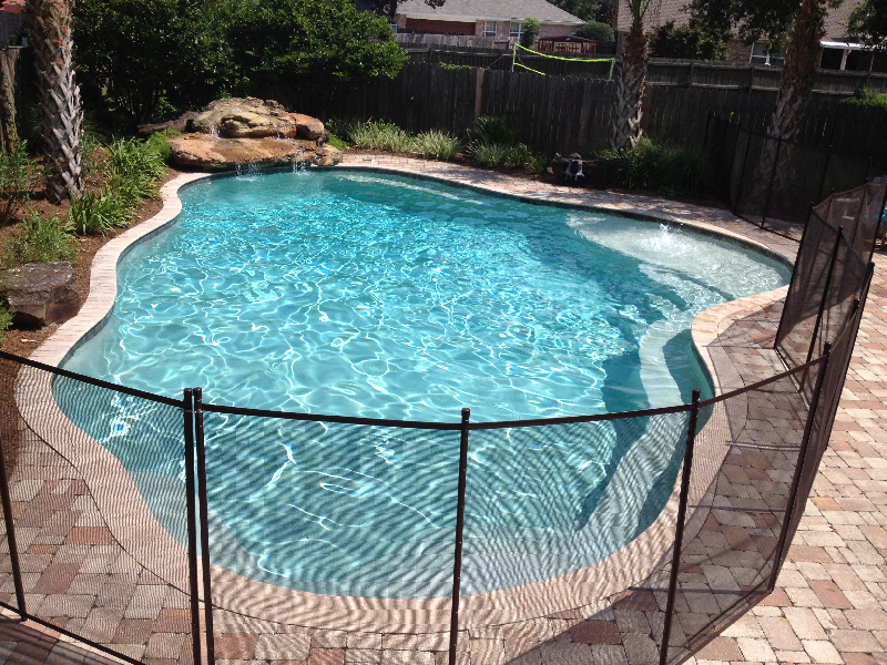 Gunite pool with safety barrier